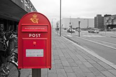 Danish mail box with inscriptions about work on a black and white background Royalty Free Stock Photo