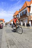 Danish man bicycling on street in Denmark Stock Image
