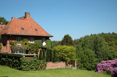 Danish Mansion in the summertime. Mansion located ind the woods north of Copenhagen Stock Image