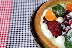 Danish pancake with berries and whipped cream topping. Covered with sugar powder Royalty Free Stock Photo