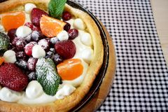 Danish pancake with berries and whipped cream topping. Covered with sugar powder Stock Images