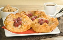 Danish pastries. With raspberries on a wooden table Stock Image