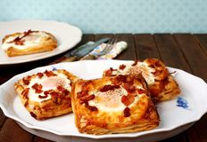 Danish pastries, breakfast with egg, bacon, cheese and puff pastries Stock Images