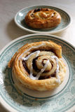 Danish Pastries. Two Danish Pastries On Plates Stock Photos
