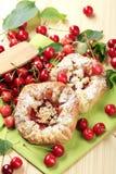 Danish pastry. Crisp Danish pastry and fresh cherries Stock Image