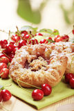 Danish pastry. Crisp Danish pastry and fresh cherries - detail Royalty Free Stock Photography