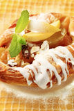 Danish pastry. With apple filling and icing Stock Photos