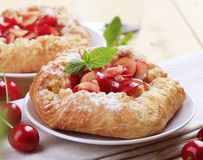 Danish pastry. With fresh cherries - closeup Royalty Free Stock Photography