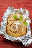 Danish pastry. Danish pastries with nut filling in tinfoil Stock Images