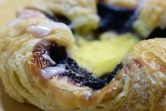 Danish pastry with blueberry and custard royalty free stock photo