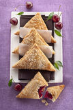 Danish Pastry. Cherry Turnovers on plate Royalty Free Stock Images