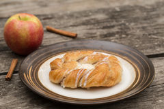 Danish Pastry With Cinnamon Sticks and Apple Stock Photography