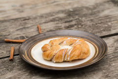 Danish Pastry With Cinnamon Sticks Stock Photos