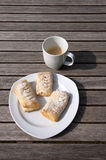 Danish pastry and cup of coffee. Wooden table royalty free stock images