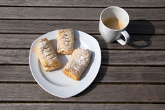 Danish pastry and cup of coffee. Wooden table stock image