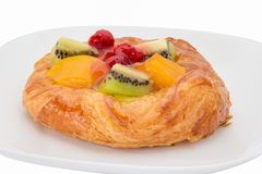 Danish pastry with fruits. On white background Stock Photography