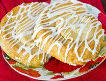 Danish Pastry with Icing. On Plate Stock Photography