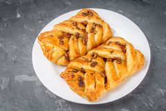 Danish pastry maple pecan with nuts and maple syrup. Danish pastry maple pecan with nuts and maple syrup royalty free stock photo