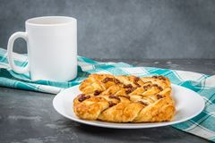 Danish pastry maple pecan with nuts and maple syrup. Danish pastry maple pecan with nuts and maple syrup royalty free stock image