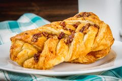 Danish pastry maple pecan with nuts and maple syrup. Danish pastry maple pecan with nuts and maple syrup stock photos