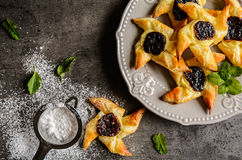 Danish pastry with pudding and plum jam. Homemade Danish pastry with vanilla pudding and plum jam Stock Photo