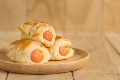 Danish Pastry with sausage on wooden dish Royalty Free Stock Images