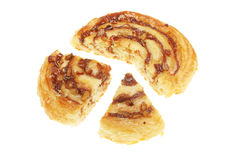 Danish pastry sections. Danish pastry cut in sections isolated on white Stock Image