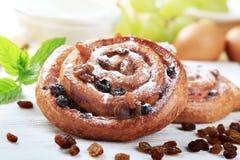 Danish pastry snails. Detail of crisp Danish pastry with raisins Stock Photos