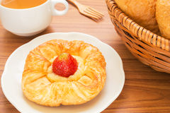 Danish pastry with tea cup Stock Image