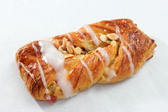 A Danish pastry twist on white dish. Stock Images
