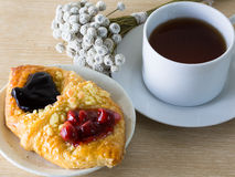 Danish pastry on wooden table. Fruit, peach danish on wooden table Royalty Free Stock Photography
