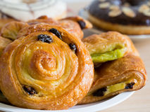 Danish pastry on wooden table Stock Photo