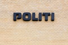 Danish police sign on a wall royalty free stock photography