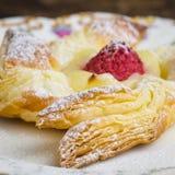 Danish puff pastry pinwheels with vanilla pastry cream and raspb