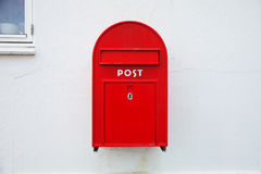 Danish red mailbox on the wall. Danish red mailbox on wall royalty free stock photo