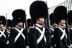 The Danish royal guard. Through the city of copenhagen to make the change of guard at the royal palace Royalty Free Stock Images