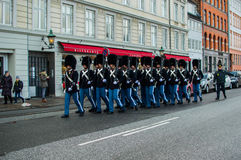 The Danish royal guard. Through the city of copenhagen to make the change of guard at the royal palace Royalty Free Stock Photo