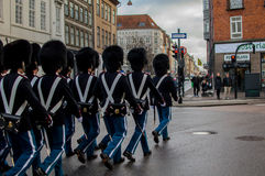 The Danish royal guard. Through the city of copenhagen to make the change of guard at the royal palace Stock Photos