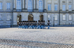 Danish Royal Guards marching in Copenhagen. The Danish Royal Life Guards marching as part of the changing of the guard ceremonyin front of the Amalienborg Palace Stock Photography
