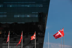 Danish Royal Library and Danish flag in Copenhagen Stock Image