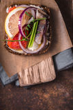 Danish sandwich with fish on the parchment closeup Royalty Free Stock Photo