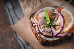 Danish sandwich with fish on parchment Royalty Free Stock Photography