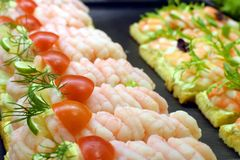 Danish sandwiches. Delicious Danish sandwiches with prawns, boiled eggs, tomato and lemon Royalty Free Stock Photography