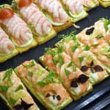 Danish sandwiches. Delicious Danish sandwiches with prawns, boiled eggs, tomato and lemon Stock Photo