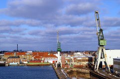 Danish Shipyard. Frederik's Harbour (frederikshavn) Denmark.  A shipping and transportation port with cranes for cargo ships to load and unload freight Royalty Free Stock Photos