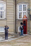 Danish soldier guarding Amalienborg Palace .Amalienborg palace i Stock Photos