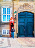 Danish soldier guarding Amalienborg Palace. Amalienborg palace is the Danish Royal residence. Danish soldier guarding Amalienborg Palace. Oil painting effect Royalty Free Stock Photo