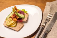 Danish specialties and national dishes, high-quality open sandwich. Liver Pate with bacon pickled cucumber, beetroot and cucumber served on a plate ready for Stock Images