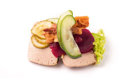 Danish specialties and national dishes, high-quality open sandwich. Liver Pate with bacon pickled cucumber, beetroot and cucumber isolated on white background Royalty Free Stock Images