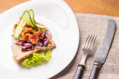 Danish specialties and national dishes, high-quality open sandwich. The very famous piece of butterbread called Veterinarian`s midnight snack consisting of Royalty Free Stock Photos